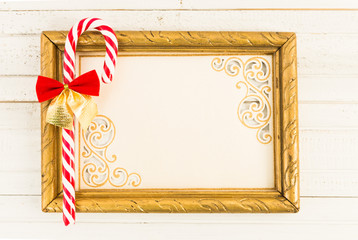 Empty picture frame with Christmas cane candy
