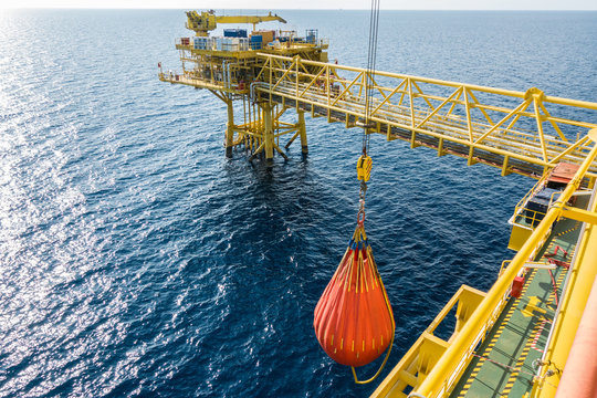 Yearly preventive maintenance of platform pedestal crane with water bag load dummy, full load test at twenty eight tone safe working load testing at offshore oil and gas platform.