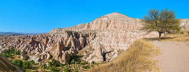 Rose or Red valley landscape in Cappadocia, Turkey. Scenic Background with rocky hills of sandstone and tuff. Geological and tourist concept