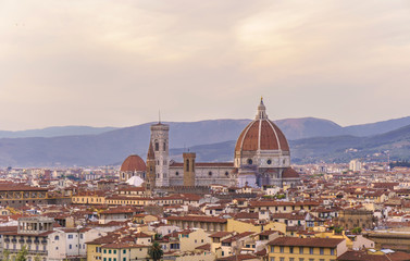 Panorama of Florence with Santa Maria del Fiore cathedral at sunset time.