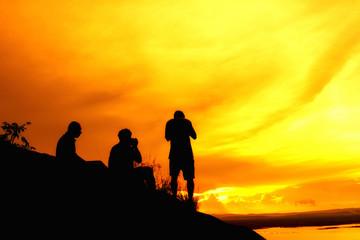 Silhouette photographer on mountain,Photographer shooting sunset,Beauty sunset,Shooting photographer with sunset public landmark