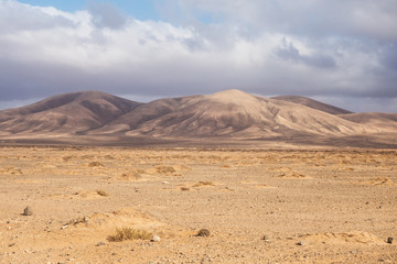 Dry out desert in Fuerteventura with mountains behind