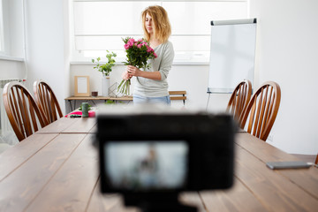 Image of florist woman recording to camera master class