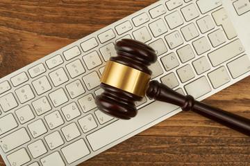 Judge gavel on computer keyboard.