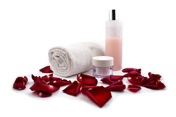 Rose cosmetics stock images. Rose cosmetics on a white background. Rose petals with cosmetics