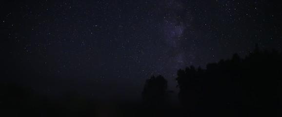 Night sky over rural landscape. Beautiful night starry sky