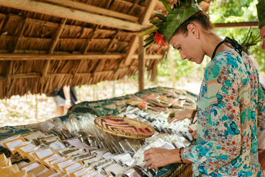 Female tourist selects spices on the market