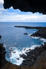 Cliffs and pacific ocean landscape vue from Ana Kakenga cave in Easter island