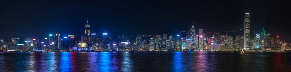 Colorful panoramic view of Hong Kong skyline on night time seen from Kowloon. Hong Kong, China. Fotomurales