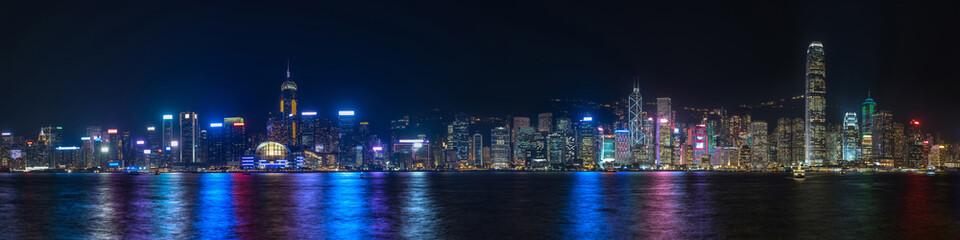 Colorful panoramic view of Hong Kong skyline on night time seen from Kowloon. Hong Kong, China. Fotomurales
