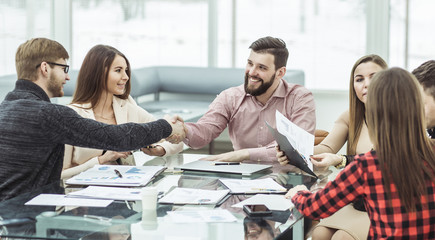 handshake financial partners after the discussion of a new contract