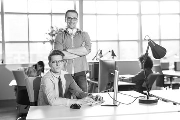 Two Business People Working With computer in office