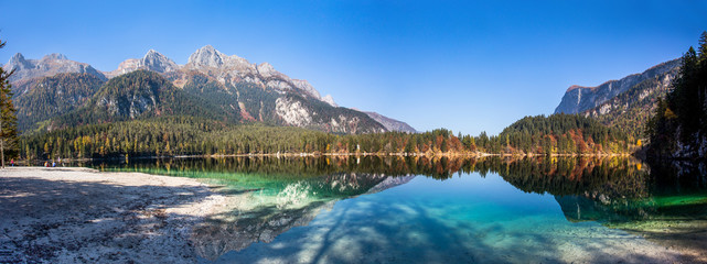 Autumnal panoramic view of Tovel lake, Val di Non within the Adamello-Brenta Natural Park, Trentino Alto-Adige, Italy.