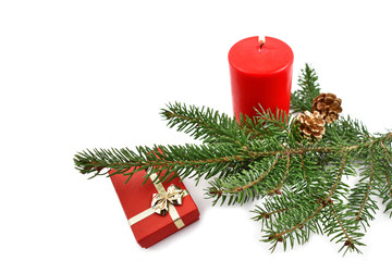 Christmas still life stock images. Red candle with twig. Christmas decoration photography. Red christmas decoration on a white background. Red gift box