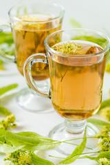 Linden herbal tea in transparent grog glass
