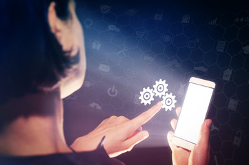 Image of a girl with a smartphone in hands. She presses on the gears icon. Concept of setting and support service.