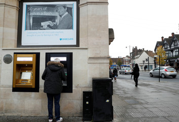 A gold coloured ATM is seen as it commemorates the location of the world's first cash machine in Lodon