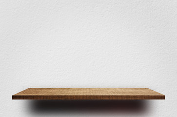 Empty wooden shelves with white cement wall for product display