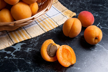 Fresh organic apricots in basket. Group of harvested apricots in basket..