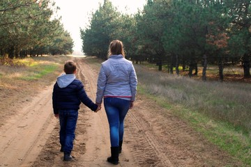 Children are walking and holding hands