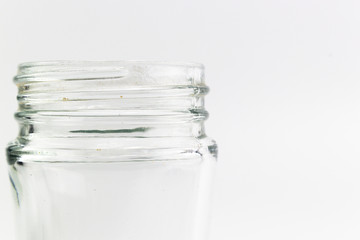 Closed up of transparent glass of bottle with spiral on top