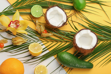 Composition with tropical leaves and exotic fruits on color background
