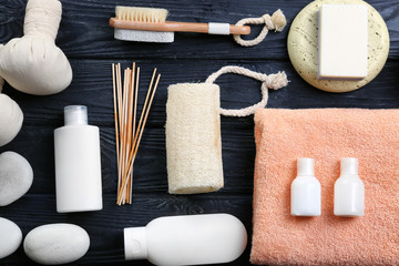 Composition with towel and bath accessories on wooden background