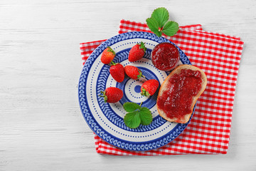 Bread with strawberry jam and fresh berries on plate