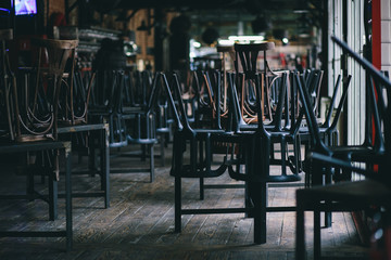 Chairs and tables stacked in a closed pub Wall mural
