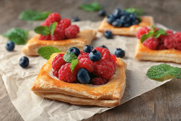 Delicious pastry with berries on table