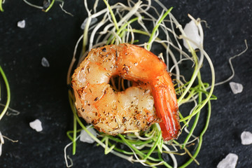 Delicious grilled shrimp on table