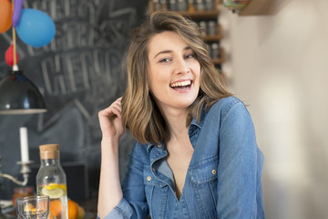 Portrait of laughing woman in the kitchen