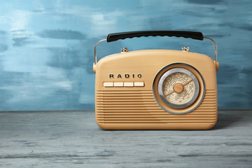 Retro radio on color background