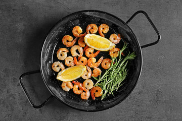 Dish with delicious grilled shrimps on table