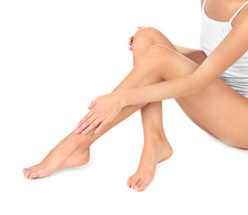 Young woman with beautiful legs on white background