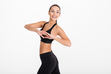 Gorgeous young sports woman make exercises.