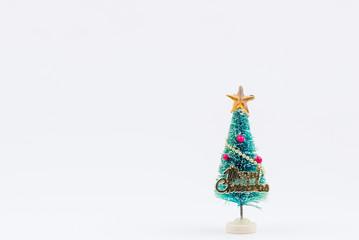 Tiny christmas tree isolated on white background.