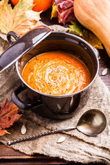 Photo of useful soup puree, pumpkin on linen cloth