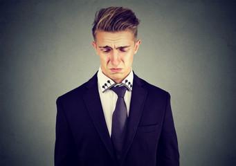 Closeup of a sad crying young business man