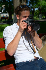 Young man taking a photo.
