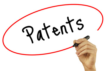 Man Hand writing Patents with black marker on visual screen. Isolated on background. Business, technology, internet concept. Stock Photo