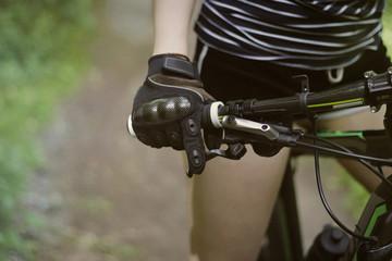 Foto op Plexiglas Young girl on bike in gloves
