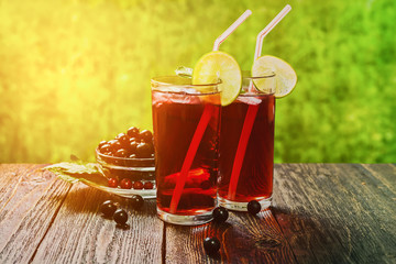 The juice of black currant in glass panes on the table