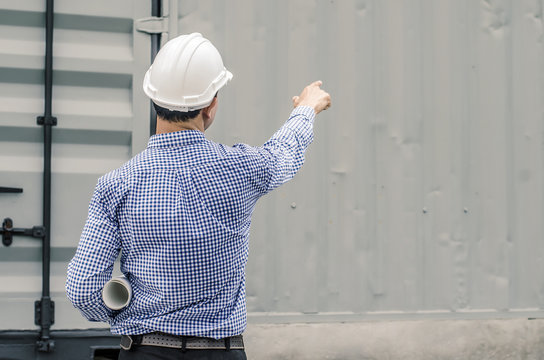 Male architect and blueprints with white helmet pointing finger on a construction site,Architects on construction site check documents and business workflow