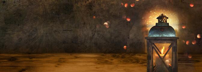 Dark concrete wall with lantern on wood