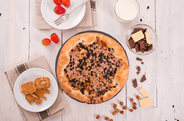 Sweet chocolate pizza with cookies.