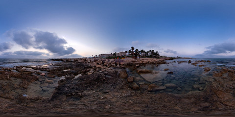 Evening view of the city Paphos, Cyprus. Coast line with stones, sea, sand, beach, trees. 360 degree spherical panorama or hdr map.