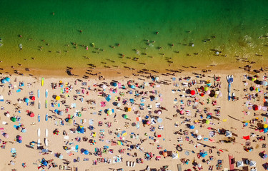 Aerial Summer View Of People Crowd Having Fun On Cascais Beach In Portugal