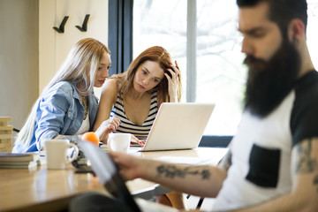 Women working together on laptop computer