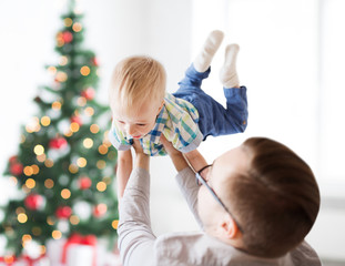 happy father playing with son at christmas